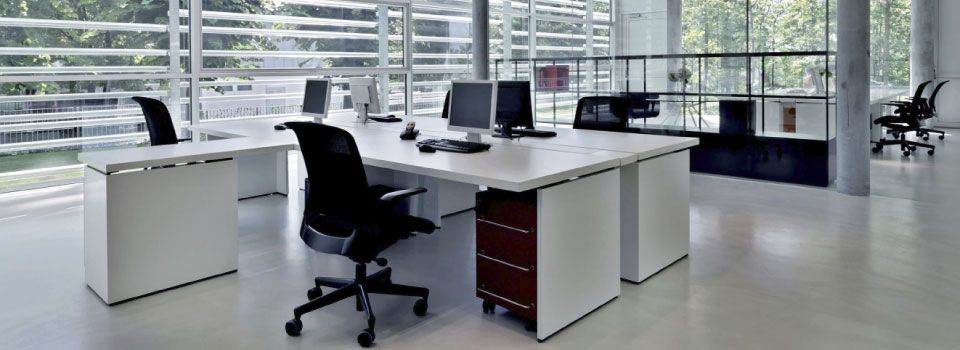 modern bright office space with white desks